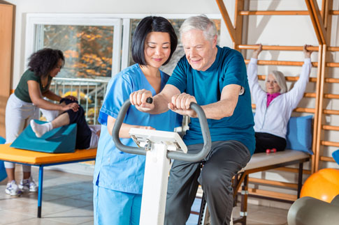 Older male going through physical therapy